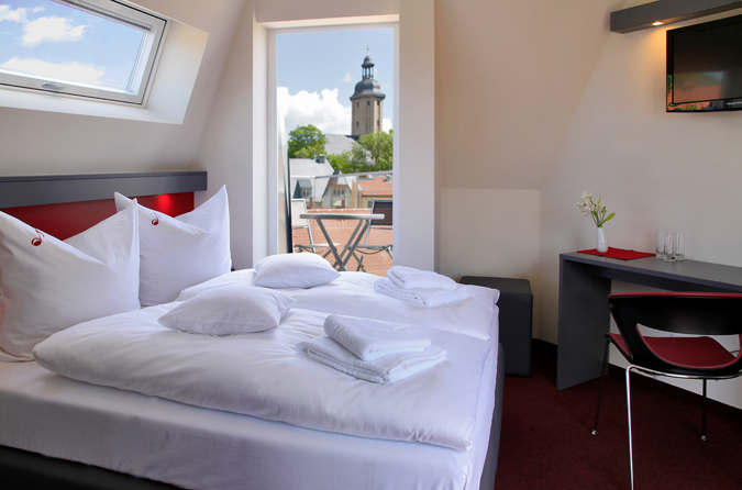 Our room with terrace, balcony and the fantastic view to the rooftops and landscape of Jena.
